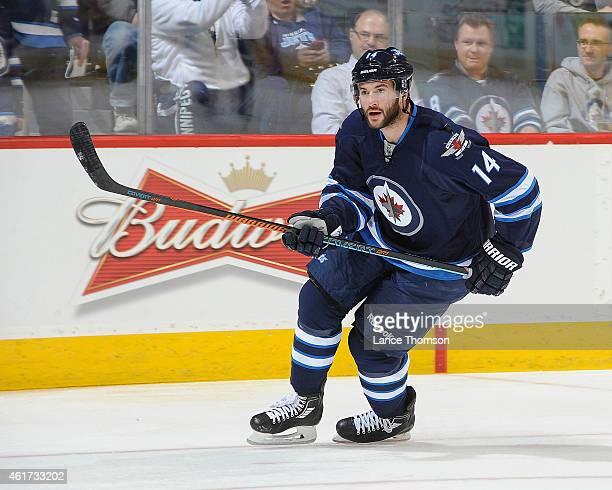 Anthony Peluso of the Winnipeg Jets takes part in the pregame warm up prior to the NHL game against the Florida Panthers on January 13 2015 at the...