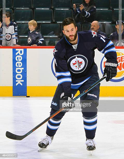 Anthony Peluso of the Winnipeg Jets takes part in the pregame warm up prior to NHL action against the Dallas Stars on February 24 2015 at the MTS...