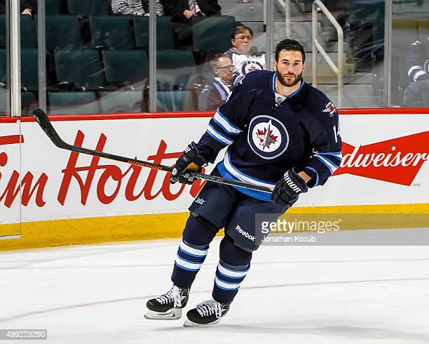 Anthony Peluso of the Winnipeg Jets takes part in the pregame warm up prior to NHL action against the Colorado Avalanche at the MTS Centre on...
