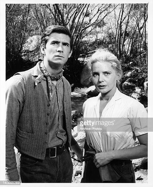Anthony Perkins and Elaine Aiken have serious look as they look up outside in a scene from the film 'The Lonely Man' 1957