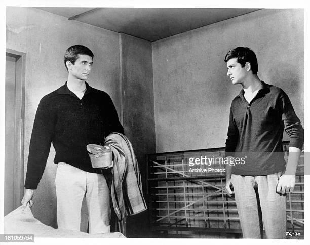 Anthony Perkins and Jean Claude Brialy meet face to face in a scene from the film 'Le Glaive Et La Balance' 1963