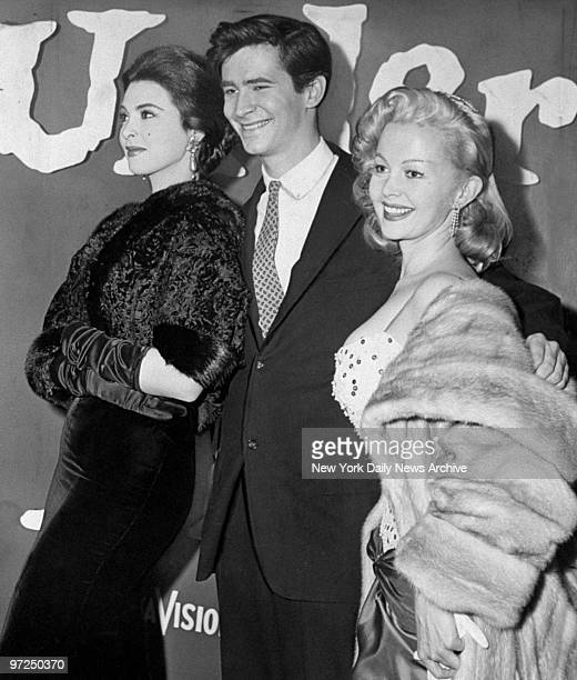 Anthony Perkins with actresses Tina Louise and Greta Thyssen attending the debut of Desire Under the Elms at the Odeon Theatre He's in the film