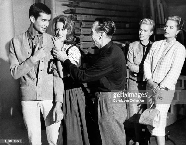 Anthony Perkins with Jane Fonda Martha Hyer and her sister on the set of the movie 'Tall Story' in 1960