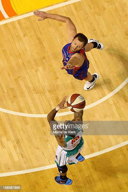 Anthony Petrie of Adelaide tries to block a shot from Gary Ervin of Townsville during the round 11 NBL match between the Adelaide 36ers and the...