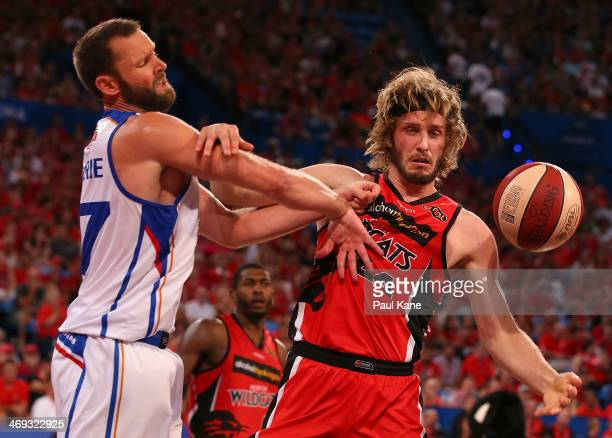 Anthony Petrie of the 36ers and Jesse Wagstaff of the Wildcats contest for a loose ball during the round 18 NBL match between the Perth Wildcats and...