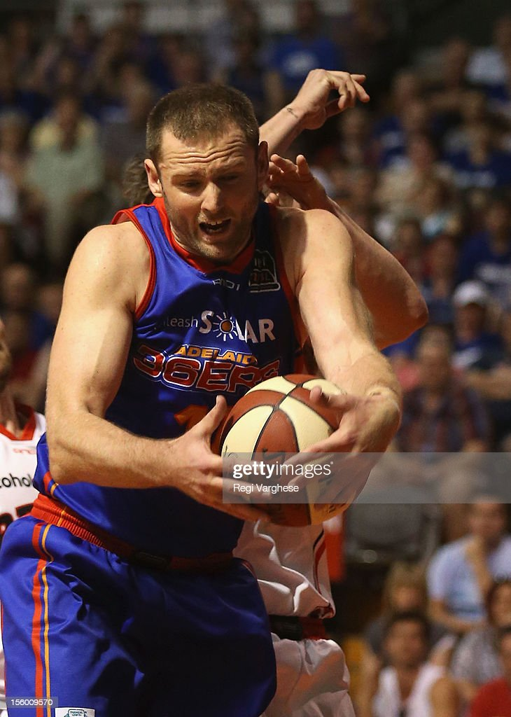 Anthony Petrie of the 36ers under pressure from Greg Hire of the Wildcats during the round six NBL match between the Adelaide 36ers and the Perth Wildcats at Adelaide Arena on November 11, 2012 in Adelaide, Australia.