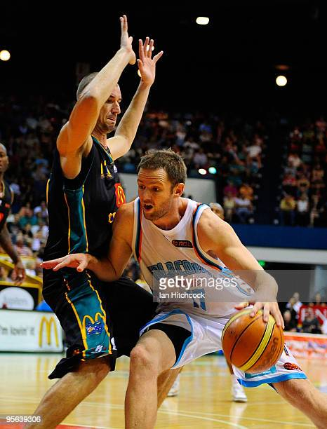Anthony Petrie of the Blaze looks to get past Russell Hinder of the Crocodiles during the round 15 NBL match between the Townsville Crocodiles and...
