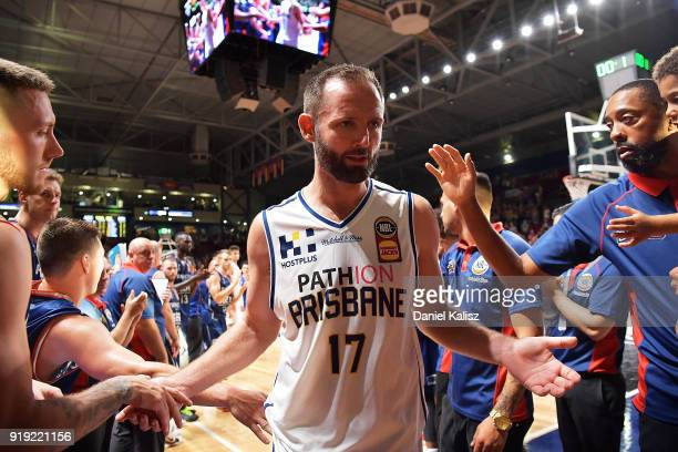 Anthony Petrie of the Brisbane Bullets receives a guard of honour after competeing in his 250th game during the round 19 NBL match between the...
