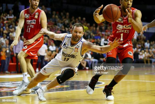 Anthony Petrie of the Bullets dives for the ball during the round three NBL match between the Illawarra Hawks and the Brisbane Bullets at Wollongong...