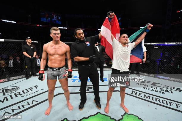 Anthony Pettis celebrates his KO victory over Stephen Thompson in their welterweight bout during the UFC Fight Night event at Bridgestone Arena on...