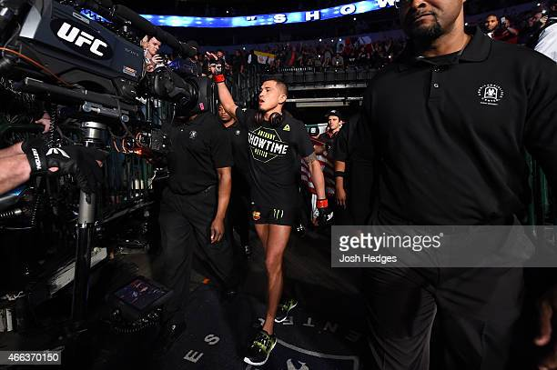 Anthony Pettis enters the arena before facing Rafael dos Anjos of Brazil in their UFC lightweight championship bout during the UFC 185 event at the...