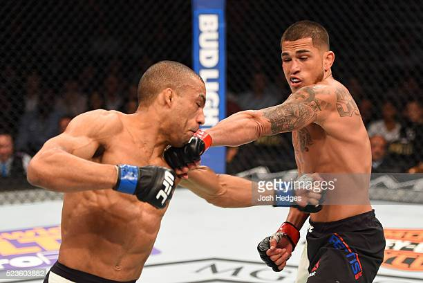 Anthony Pettis exchange punches with Edson Barboza in their lightweight bout during the UFC 197 event inside MGM Grand Garden Arena on April 23 2016...