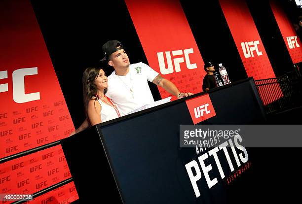 Anthony Pettis interacts with a fan at the UFC Fan Expo in the Sands Expo and Convention Center on July 10 2015 in Las Vegas Nevada