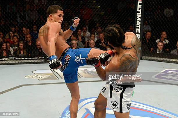 Anthony Pettis kicks Benson Henderson in their UFC lightweight championship bout at BMO Harris Bradley Center on August 31 2013 in Milwaukee Wisconsin