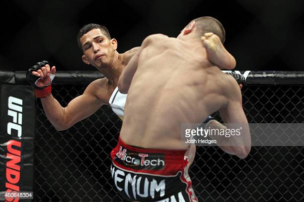 Anthony Pettis kicks Joe Lauzon during the UFC 144 event at Saitama Super Arena on February 26, 2012 in Saitama, Japan.