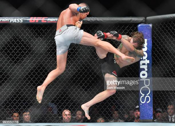 Anthony Pettis kicks Michael Chiesa during their lightweight fight at TMobile Arena on July 7 2018 in Las Vegas Nevada Pettis won by second round...