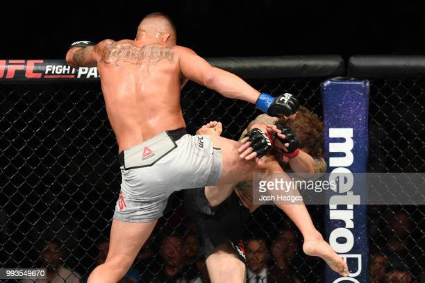 Anthony Pettis kicks Michael Chiesa in their lightweight fight during the UFC 226 event inside TMobile Arena on July 7 2018 in Las Vegas Nevada