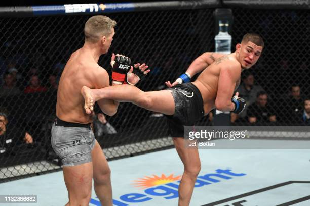 Anthony Pettis kicks Stephen Thompson in their welterweight bout during the UFC Fight Night event at Bridgestone Arena on March 23 2019 in Nashville...