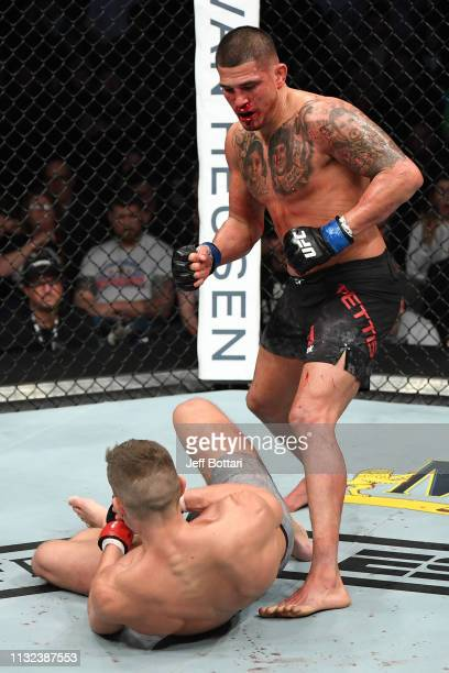 Anthony Pettis knocks down Stephen Thompson in their welterweight bout during the UFC Fight Night event at Bridgestone Arena on March 23 2019 in...