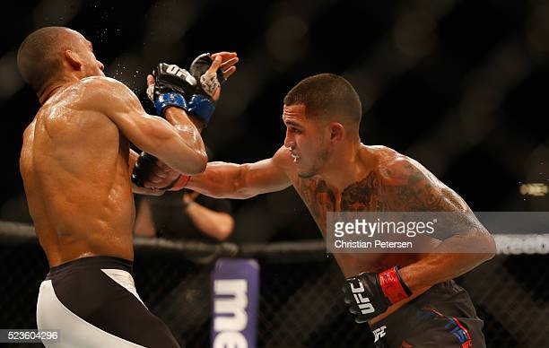 Anthony Pettis punches Edson Barboza in their lightweight bout during the UFC 197 event inside MGM Grand Garden Arena on April 23 2016 in Las Vegas...