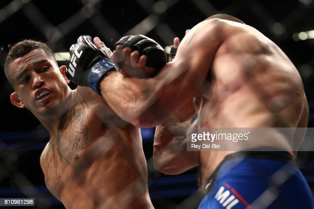 Anthony Pettis punches Jim Miller in their lightweight bout during the UFC 213 event at TMobile Arena on July 9 2017 in Las Vegas Nevada