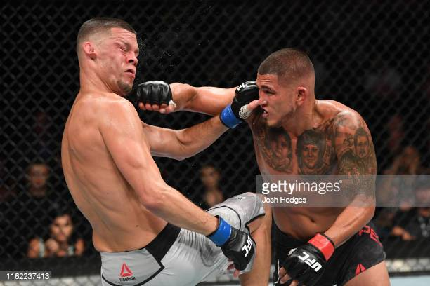 Anthony Pettis punches Nate Diaz in their welterweight bout during the UFC 241 event at the Honda Center on August 17 2019 in Anaheim California
