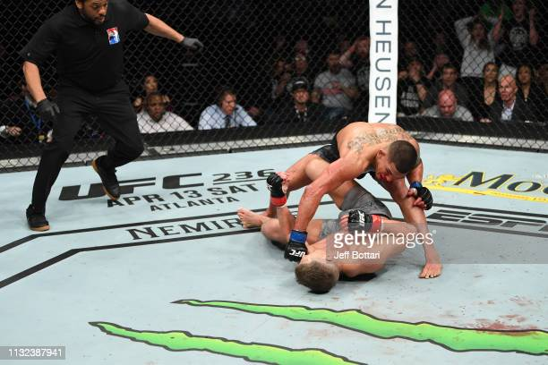 Anthony Pettis punches Stephen Thompson in their welterweight bout during the UFC Fight Night event at Bridgestone Arena on March 23 2019 in...