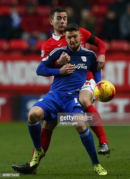 Anthony Pilkington of Cardiff and Harry Lennon of Charlton battle for the ball during the Sky Bet Championship match between Charlton Athletic and...
