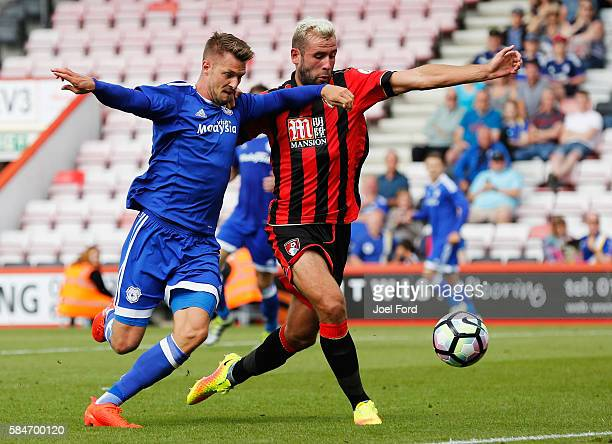Anthony Pilkington of Cardiff City and Steve Cook of Bournemouth battle for the ball during a preseason match between Bournemouth and Cardiff City at...