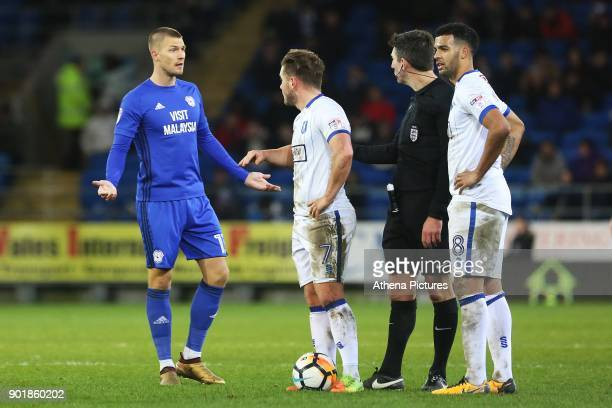 Anthony Pilkington of Cardiff City argues with Referee Lee Probert during the Fly Emirates FA Cup Third Round match between Cardiff City and...