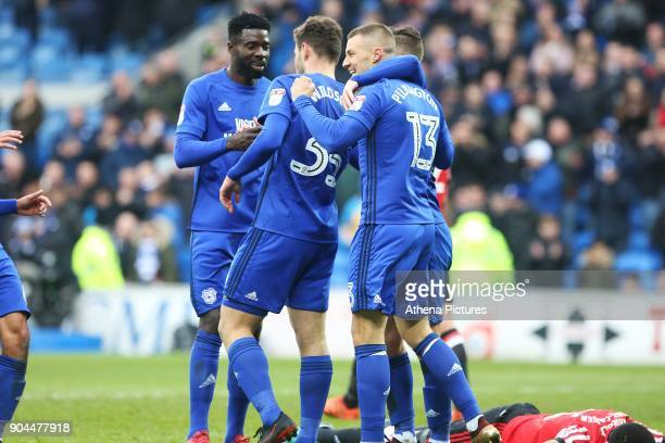 Anthony Pilkington of Cardiff City celebrates scoring his sides fourth goal of the match with Yanic Wildschut and Joe Bennett during the Sky Bet...