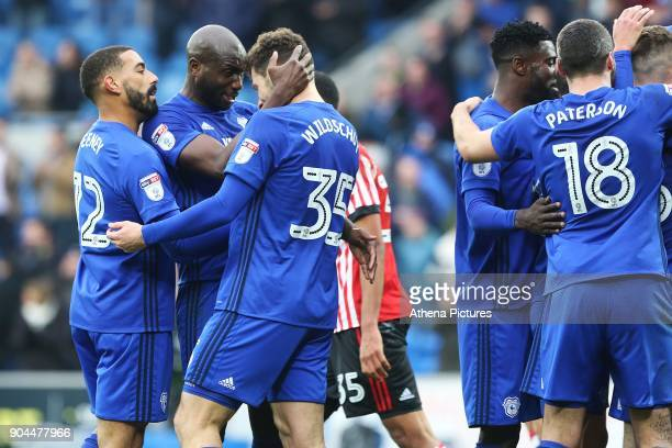 Anthony Pilkington of Cardiff City celebrates scoring his sides fourth goal of the match as Sol Bamba congratulates Yanic Wildschut for his assist...