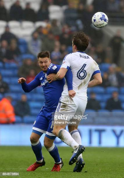 Anthony Pilkington of Cardiff City contends with Christophe Berra of Ipswich Town for the aerial ball during the Sky Bet Championship match between...