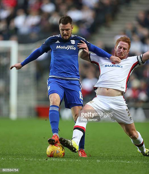 Anthony Pilkington of Cardiff City contests the ball with Dean Lewington of Milton Keynes Dons during the Sky Bet Championship match between Mlton...