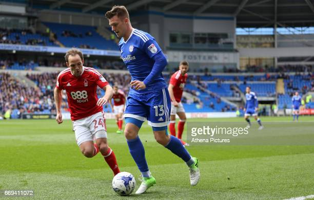 Anthony Pilkington of Cardiff City is closely marked by David Vaughan of Nottingham Forest during the Sky Bet Championship match between Cardiff City...