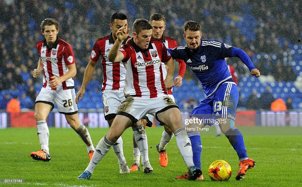 Anthony Pilkington of Cardiff City is tackled by Jack O'Connell of Brentford during the Sky Bet Championship match between Cardiff City and Brentford at the Cardiff City Stadium on December 15, 2015 in Cardiff, Wales.