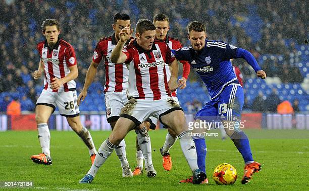 Anthony Pilkington of Cardiff City is tackled by Jack O'Connell of Brentford during the Sky Bet Championship match between Cardiff City and Brentford...