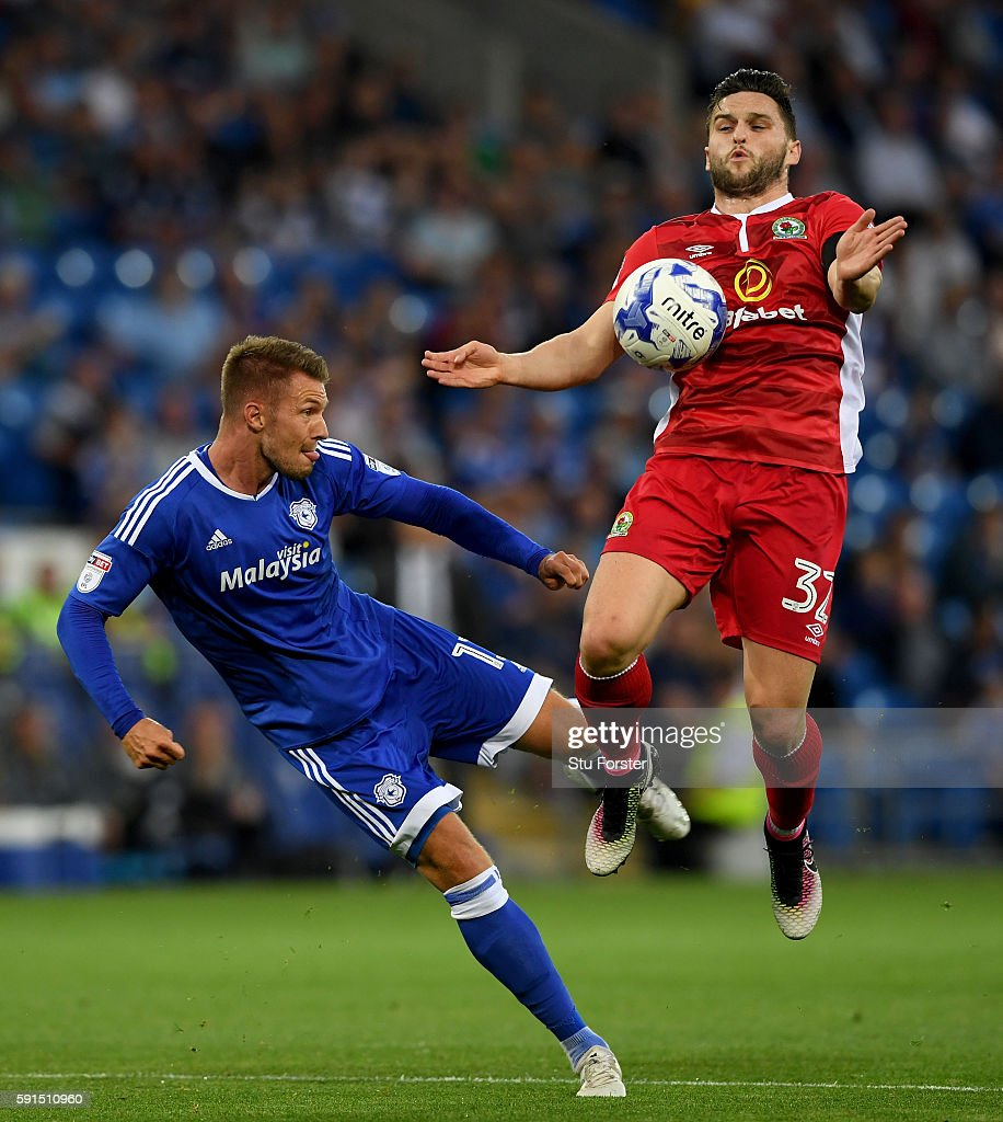Anthony Pilkington of Cardiff (l) is challenged by Craig Conway of Blackburn during the Sky Bet Championship match between Cardiff City and Blackburn Rovers at Cardiff City Stadium on August 17, 2016 in Cardiff, Wwales..