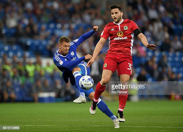 Anthony Pilkington of Cardiff is challenged by Craig Conway of Blackburn during the Sky Bet Championship match between Cardiff City and Blackburn...