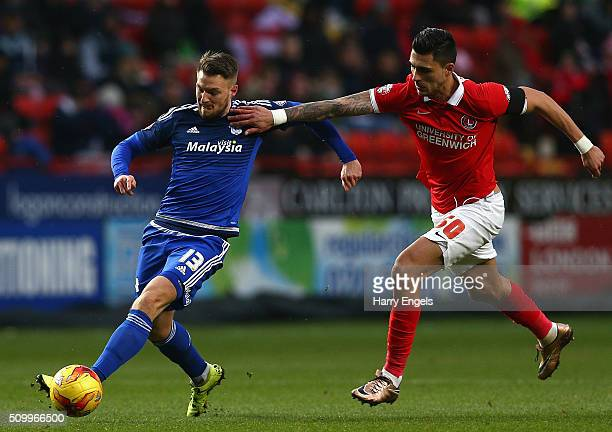 Anthony Pilkington of Cardiff is challenged by Jorge Teixeira of Charlton during the Sky Bet Championship match between Charlton Athletic and Cardiff...