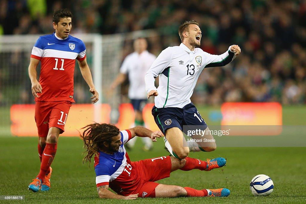 Anthony Pilkington (R) of Ireland is fouled by Kyle Beckerman of USA during the International Friendly match between the Republic of Ireland and USA at the Aviva Stadium on November 18, 2014 in Dublin, Ireland.