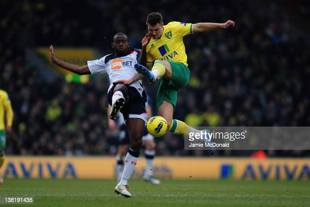 Anthony Pilkington of Norwich City battles with Zak Whitbread of Bolton Wanderers during the Barcays Premier League match between Norwich City and...