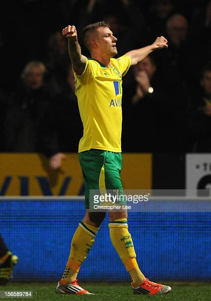 Anthony Pilkington of Norwich City celebrates his opening goal during the Barclays Premier League match between Norwich City and Manchester United at...