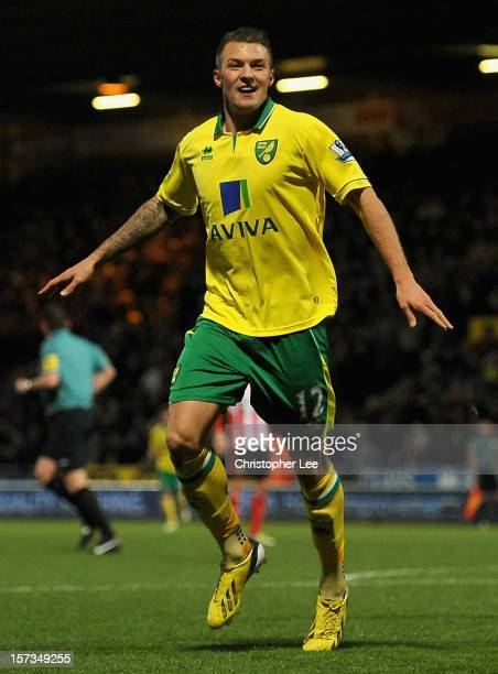 Anthony Pilkington of Norwich City celebrates scoring his side's second goal during the Barclays Premier League match between Norwich City and...