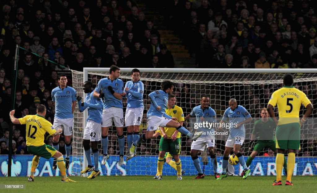 Anthony Pilkington of Norwich City scores from a free kick during the Barclays Premier League match between Norwich City and Manchester City at Carrow Road on December 29, 2012 in Norwich, England.