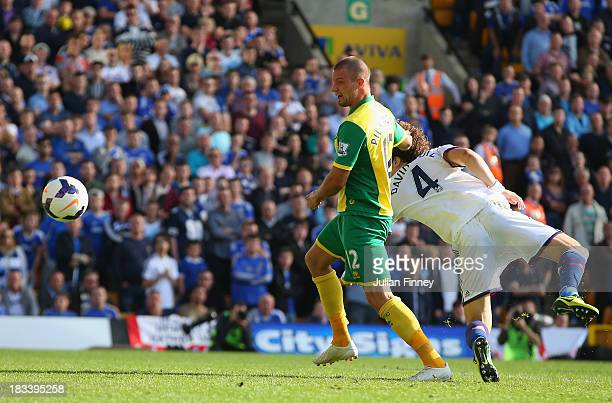 Anthony Pilkington of Norwich City scores their first goal during the Barclays Premier League match between Norwich City and Chelsea at Carrow Road...