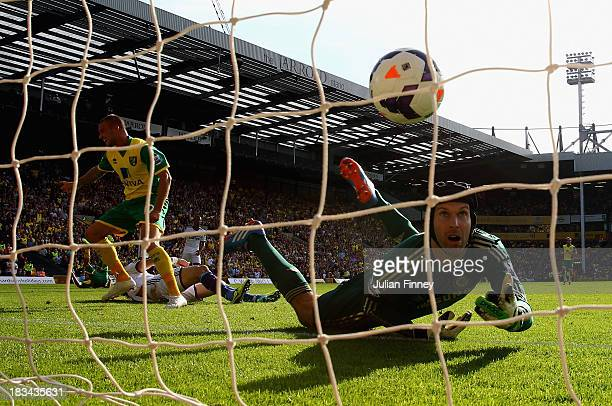 Anthony Pilkington of Norwich City turns to celebrate his goal as Petr Cech of Chelsea watches the ball go into the net during the Barclays Premier...
