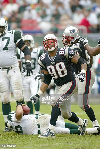 Anthony Pleasant of the New England Patriots celebrates after the score a game against the New York Jets on September 15 2002 at Giants Stadium in...