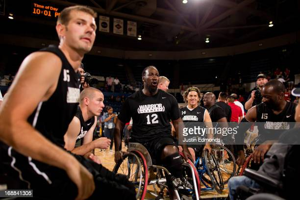 Anthony Pone of the Army celebrates with his team after they defeated the Marines 3432 in the men's wheelchair basketball gold medal match in Clue...
