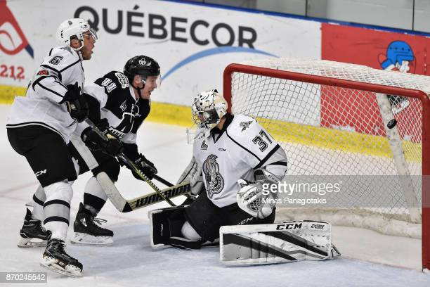 Anthony Poulin of the BlainvilleBoisbriand Armada scores a third period goal on goaltender Tristan Berube of the Gatineau Olympiques during the QMJHL...